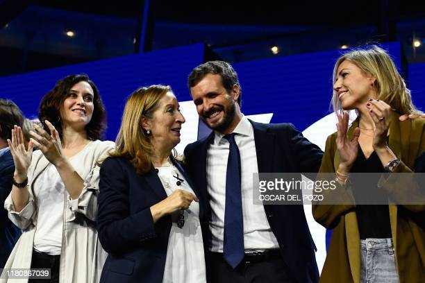 Spanish conservative People's Party leader and candidate for prime minister Pablo Casado talks to party member Ana Pastor next to Madrid's regional...
