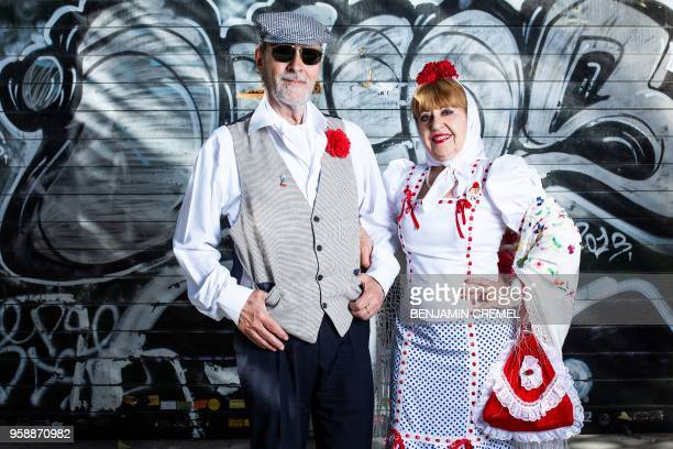 Spanish couple Esteban and Nieves dressed in traditional chulapo and chulapa garb for San Isidro celebrations pose in Madrid on May 15 2018