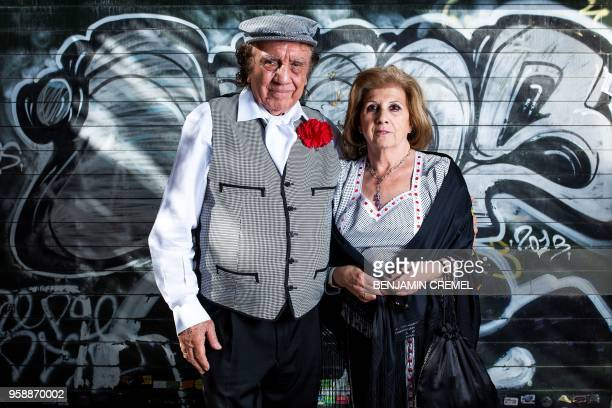 Spanish couple Gloria and Emilio dressed in traditional chulapa and chulapo garb for San Isidro celebrations pose in Madrid on May 15 2018