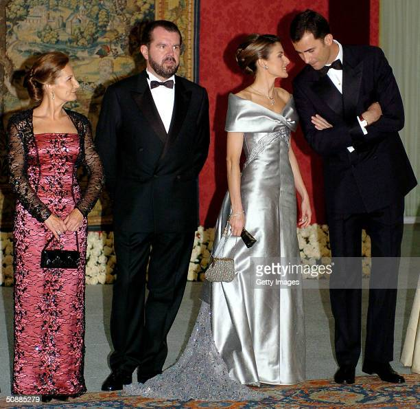 Spanish Crown Prince Felipe and his fiancee Letizia Ortiz Rocasolano pose for a picture with her father Jesus Ortiz and mother Paloma Rocasolano as...