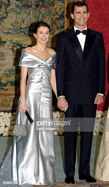 Spanish Crown Prince Felipe and his fiancee Letizia Ortiz Rocasolano pose for a picture as they attend a gala dinner at El Pardo Royal Palace May 21...