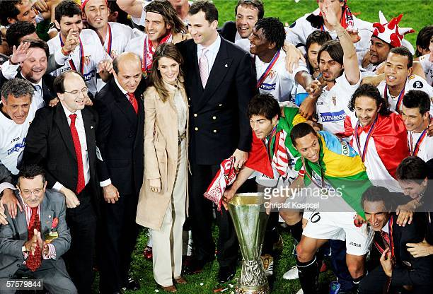 Spanish Crown Prince Felipe and Princess Letizia hold the UEFA Cup trophy as they celebrate after Sevilla FC won the UEFA Cup final against...