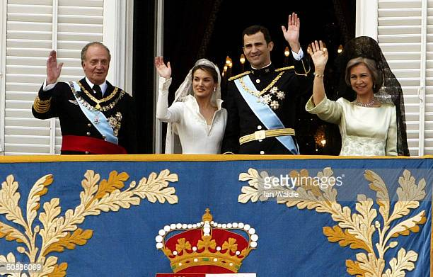 Spanish Crown Prince Felipe de Bourbon and his bride Letizia stand next to Spanish King Juan Carlos , and Queen Sofia as they appear on the balcony...