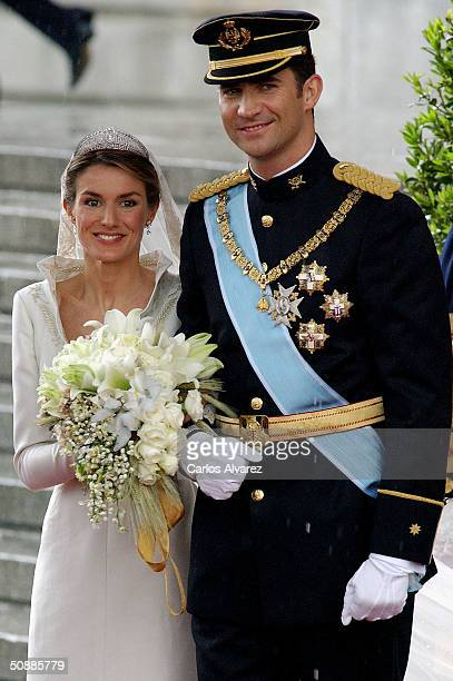 Spanish Crown Prince Felipe de Bourbon and his bride princess Letizia Ortiz leave the Almudena cathedral after their wedding ceremony May 22 2004 in...