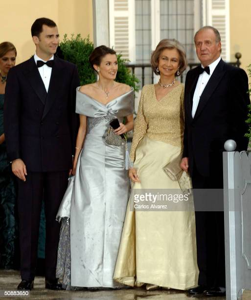 Spanish Crown Prince Felipe de Bourbon and his fiancee, former journalist Letizia Ortiz Rocasolano, pose for a picture with King Juan Carlos and...