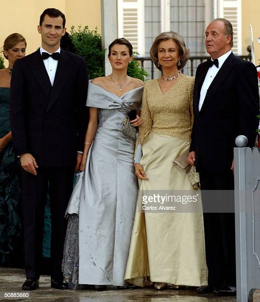 Spanish Crown Prince Felipe de Bourbon and his fiancee former journalist Letizia Ortiz Rocasolano pose for a picture with King Juan Carlos and Queen...