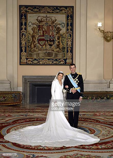 Spanish Crown Prince Felipe of Spain and his wife Princess of Asturias Letizia Ortiz pose inside the Royal Palace in Madrid 22 May 2004 POOL