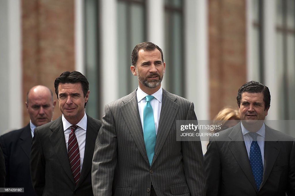Spanish Crown Prince Felipe (R) walks next to Endesa's president Borja Prado (R) and Spain's Minister for Industry, Energy and Tourism Jose Manuel Soria after inaugurating the project 'Zem2All' at the Automobile museum in Malaga on April 25, 2013. Zem2All is a pilot project, carried out alongside the Japanese government, designed to estimate usage by drivers of electric vehicles in Malaga and provide an in-depth study of the impact of these vehicles. For the four-year project 229 recharging points have been installed throughout the city and 200 e-vehicles have been distributed to participants in the project.