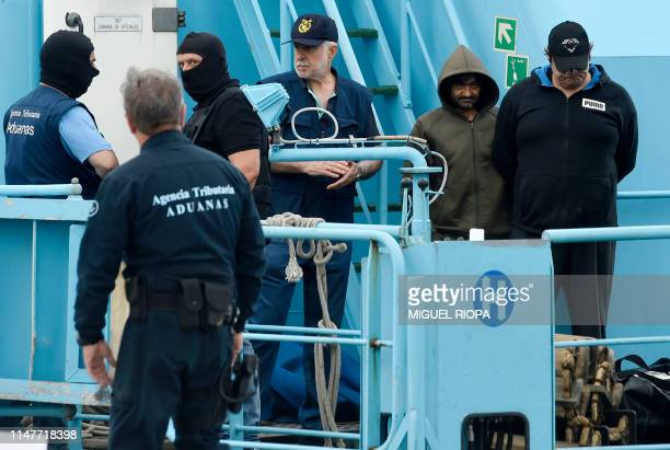 Spanish customs officers detain crew members of the vessel Gure Leire in the port of Vigo on June 3 2019 after seizing it off the Spanish coast...