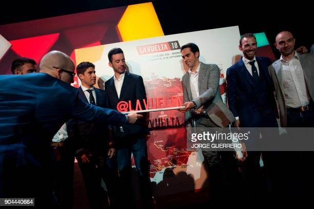 Spanish cyclist Alberto Contador holds a placard as he takes part in the presentation of the 2018 Vuelta cycling tour of Spain in Estepona on January...