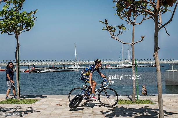 Spanish cyclist Alberto Contador of Team Saxo Tinkoff rides with his luggage before the start of the first stage of the Tour of Oman from Al Musannah...