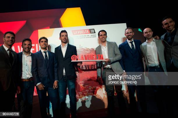 Spanish cyclist Alberto Contador poses with organisers during the presentation of the 2018 Vuelta cycling tour of Spain in Estepona on January 13...