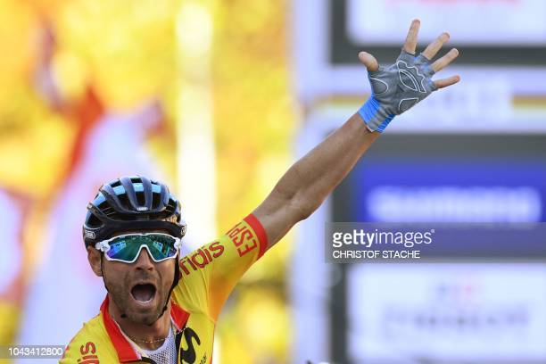 Spanish cyclist Alejandro Valverde celebrates as he wins the Men's Elite road race of the 2018 UCI Road World Championships in Innsbruck, Austria on...