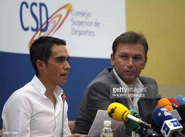Spanish cyclist and winner of Tour de France 2007 Alberto Contador reads a statement as Johan Bruyneel Sport director of the Discovery Channel Team...