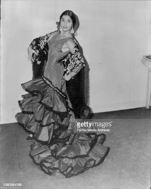 Spanish Dancer Patricia Nader strikes a Flamenco poseThe twang of the Spanish guitar the sound of a Spanish voice in song the talking of the...