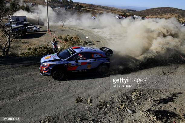 Spanish Dani Sordo and co-driver Carlos Del Barrio steer their Hyundai i20 Coupe WRC during the final day of the 2018 FIA World Rally Championship in...