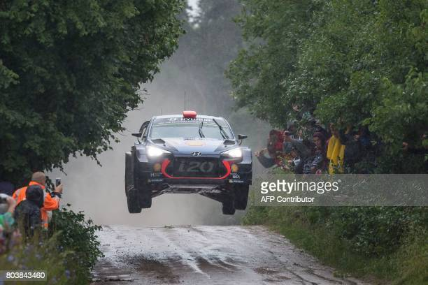 Spanish Dani Sordo and his codriver Marc Marti steer their Hyundai i20 Coupe WRC during the special stage of the Orlen Rally Poland in Chmielewo on...