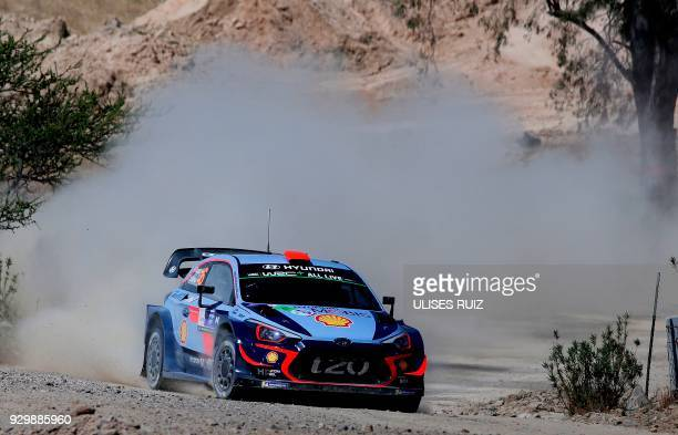 TOPSHOT Spanish Dani Sordo steers his Hyundai i20 Coupe WRC with codriver Carlos Del Barrio during the first day of the 2018 FIA World Rally...