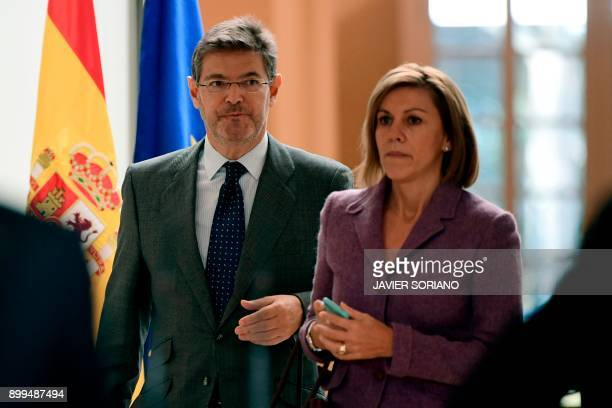 Spanish Defence Minister Maria Dolores de Cospedal and Spanish Justice Minister Rafael Catala arrive to attend the endoftheyear press conference of...