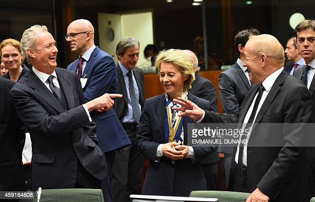 Spanish Defence Minister Pedro Morenes jokes with German Defence Minister Ursula von der Leyen and her French counterpart JeanYves Le Drian at the...