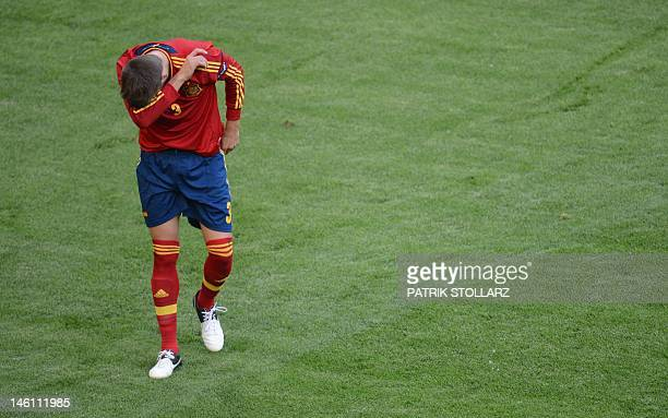 Spanish defender Gerard Pique gestures during the Euro 2012 championships football match Spain vs Italy on June 10 2012 at the Gdansk Arena AFPPHOTO/...