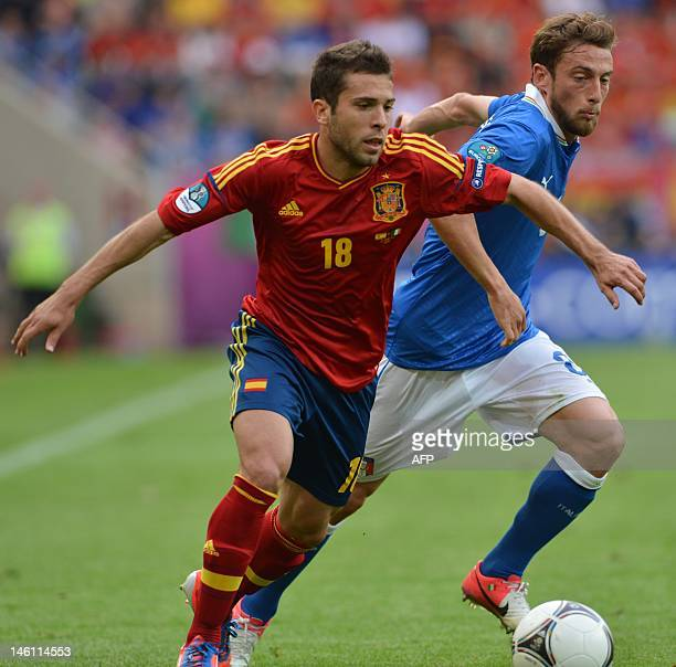 Spanish defender Jordi Alba vies with Italian midfielder Claudio Marchisio during the Euro 2012 championships football match Spain vs Italy on June...