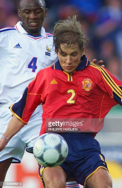Spanish defender Michel Salgado controls the ball in front of French midfielder Patrick Vieira during the Euro 2000 quarter final match between Spain...