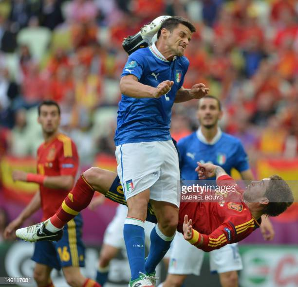 Spanish defender Raul Albiol vies with Spanish defender Sergio Ramos during the Euro 2012 championships football match Spain vs Italy on June 10 2012...