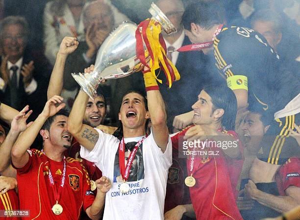 Spanish defender Sergio Ramos celebrates with the trophy and Spanish goalkeeper Iker Casillas and other teammates after the Euro 2008 championships...