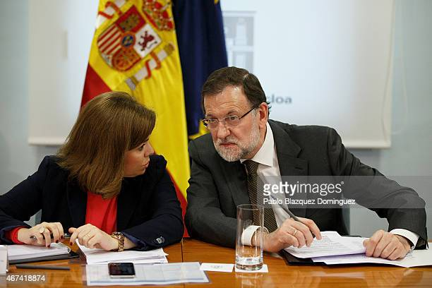 Spanish Deputy Prime Minister and Minister for the Presidency Soraya Saenz de Santamaria and Spanish Prime Minister Mariano Rajoy meet at a situation...