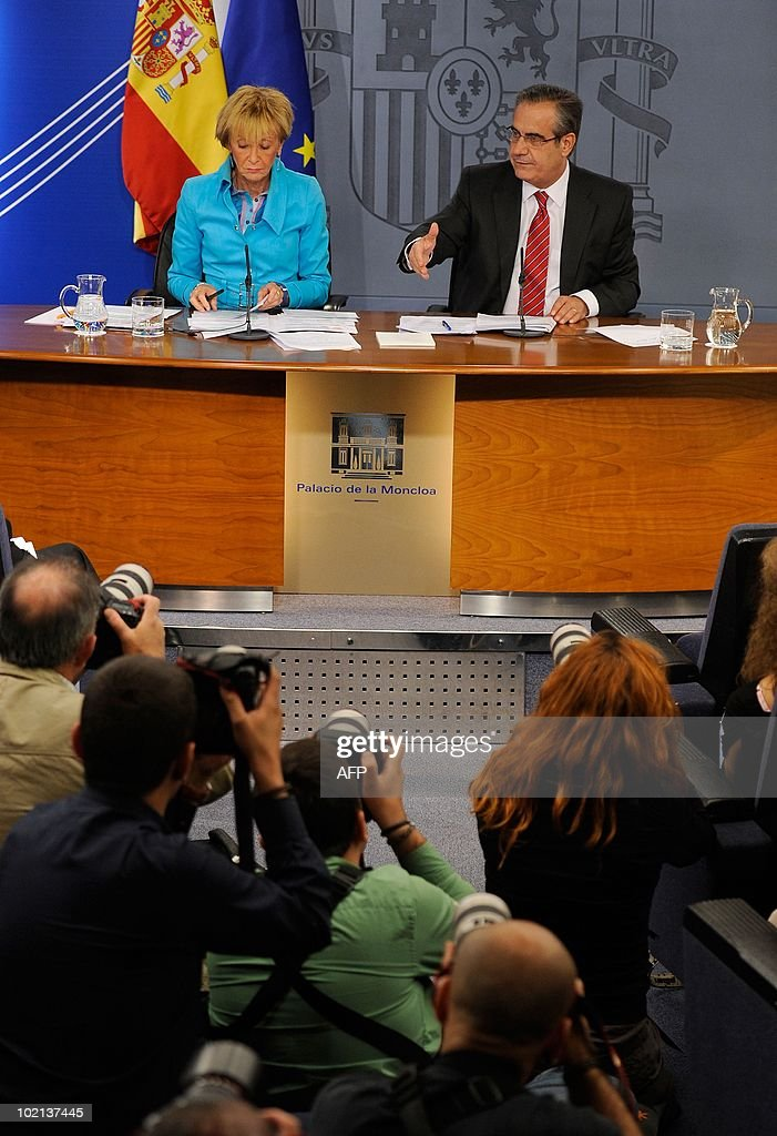 Spanish Deputy Prime Minister Maria Teresa Fernandez de la Vega (L) gives a joint press conference with Spanish Labour and Immigration Minister Celestino Corbacho at the Moncloa palace in Madrid on June 16, 2010. Spain's socialist cabinet approved a contested reform of the labour market that is deemed crucial for reviving the economy, de la Vega said. The reform -- which makes it easier and cheaper for firms to fire workers -- must still be approved by parliament, where the government is seven seats short of a majority.