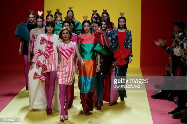 TOPSHOT Spanish designer Agatha Ruiz de la Prada walks on the catwalk with models after presenting her Fall/Winter 2018/19 collection during the...