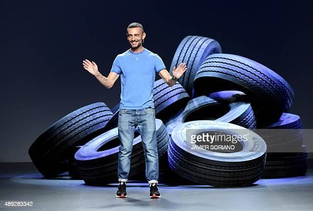 Spanish designer David Delfin greets the public after presenting his SpringSummer 2016 collection during the Madrid Fashion Week in Madrid on...