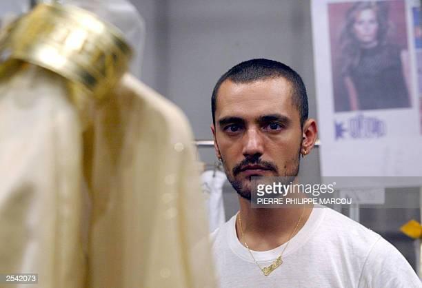 Spanish designer David Delfin poses for photographers backstage prior his Spring/Summer show during Madrid's Fashion Week in Madrid 26 September 2003...