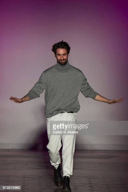 Spanish designer Juan Vidal walks the runway at the end of the Juan Vidal fashion show during the Mercedes Benz Fashion Week Autumn/Winter 2018 at...