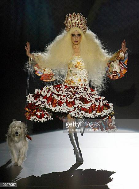 Spanish designer Nekane comes onto the catwalk with her dog Friki to present one of her creations during the Pasarela Gaudi fashion week at Barcelona...