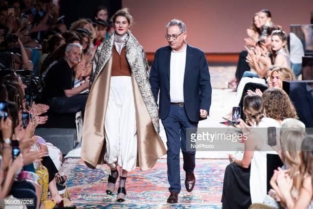 Spanish designer Roberto Verino aknowledges applause after 'Roberto Verino' catwalk during the MercedesBenz Madrid Fashion Week Spring/Summer in...