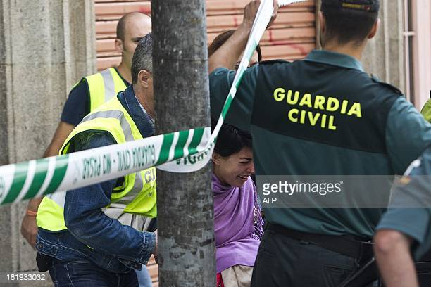 Spanish detectives detain lawyer Rosario Porto while searching her home in Santiago de Compostela on September 26 2013 as they probed the suspected...
