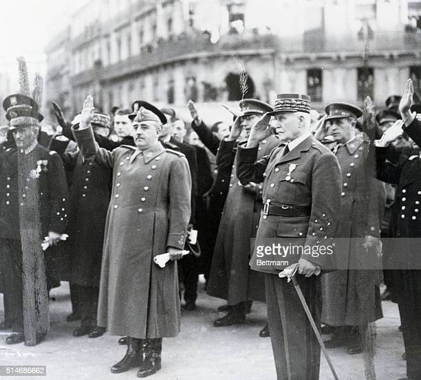 Spanish dictator Francisco Franco and Henri Petain head of state for Vichy France salute during the French national anthem during a meeting in...