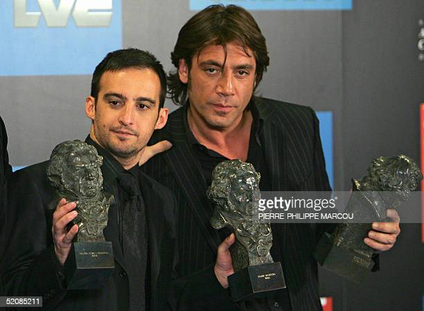 Spanish director Alejandro Amenabar who won 14 Goya Awards for Sea inside poses with awarded best actor Javier Bardem during the family picture of...