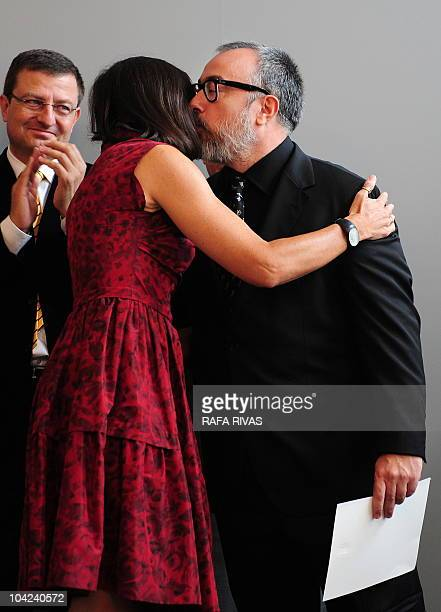 Spanish director Alex de la Iglesia kisses Spanish culture minister Angeles Gonzalez Sinde after receiving the Cinematography National Award during...