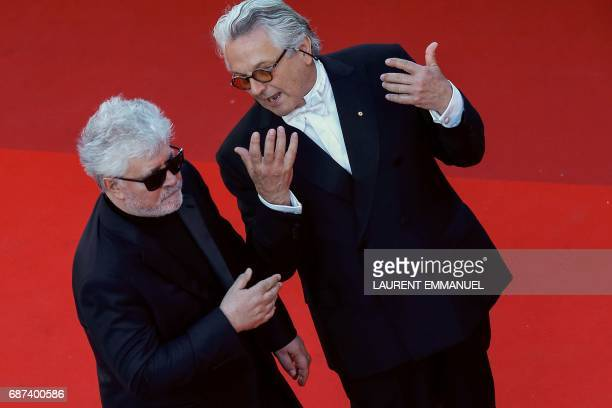 Spanish director and President of the Feature Film Jury Pedro Almodovar and Australian director George Miller talk as they arrive on May 23 2017 for...