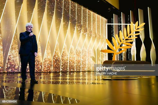 TOPSHOT Spanish director and President of the Feature Film Jury Pedro Almodovar poses stage on May 17 2017 during the opening ceremony of the 70th...