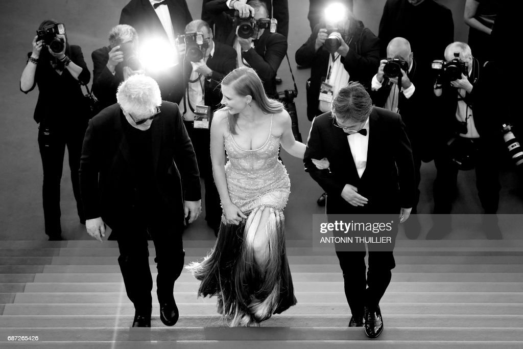 Spanish director and President of the Feature Film Jury Pedro Almodovar, US actress and member of the Feature Film jury Jessica Chastain and South Korean director and member of the Feature Film jury Park Chan-wook arrive on May 19, 2017 for the screening of the film 'Okja' at the 70th edition of the Cannes Film Festival in Cannes, southern France. / AFP PHOTO / Antonin THUILLIER