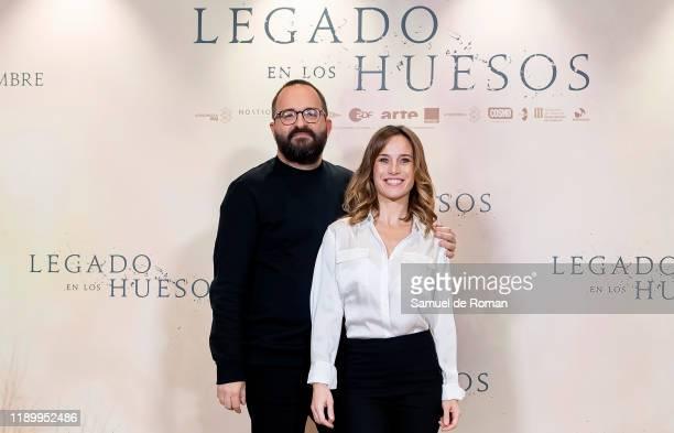 Spanish director Fernando Gonzalez and Spanish actress Marta Etura attend Legado En los Huesos Madrid Photocall on November 25 2019 in Madrid Spain