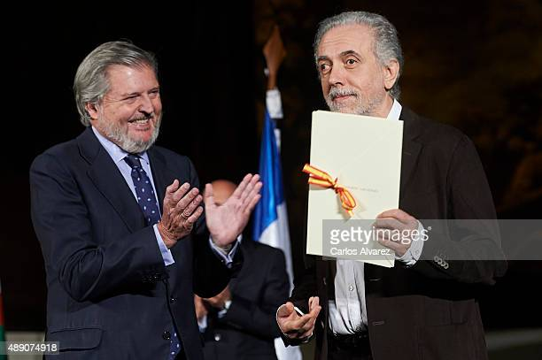 Spanish director Fernando Trueba receives from Spanish culture minister Inigo Mendez de Vigo the Cinematography Award 2015 at the San Telmo museum...