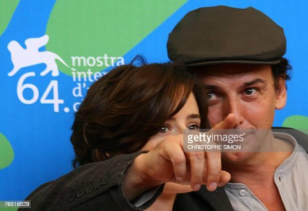 Spanish director Jose Luis Guerin and actress Pilar Lopez de Ayala pose during a photocall of En la ciudad de Sylvia during the 64th Venice...