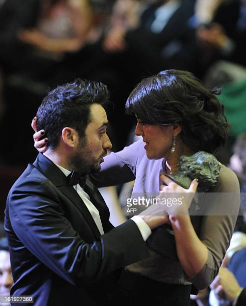 """Spanish director Juan Antonio Bayona celebrates with Maria Belon after winning the Goya award for best director for his film """"Lo Imposible"""" during..."""