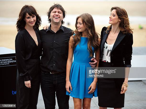 Spanish director Juan Carlos Fresnadillo poses with actresses Dutch Carice Van Houten British Ella Purnell and Spanish Pilar Lopez de Ayala pose...