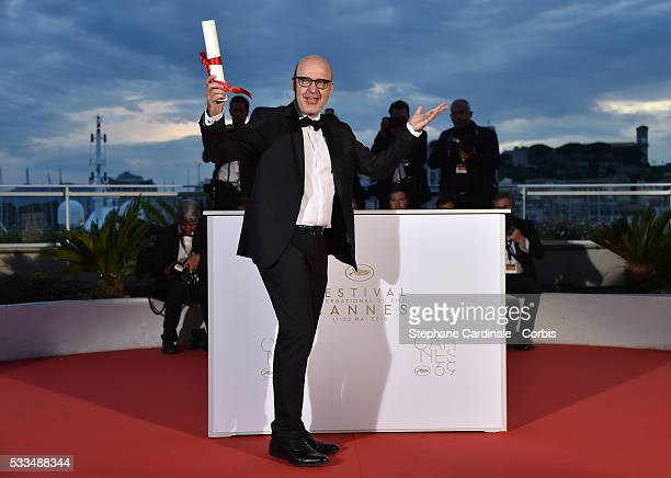 Spanish director Juanjo Gimenez poses with the Palme d'Or award for Best Short Film for 'Timecode' at the Palme D'Or Winner Photocall during the 69th...
